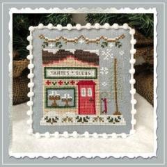 Country Cottage Needleworks Stickvorlage Snow Village 2 Skate & Sled Shop